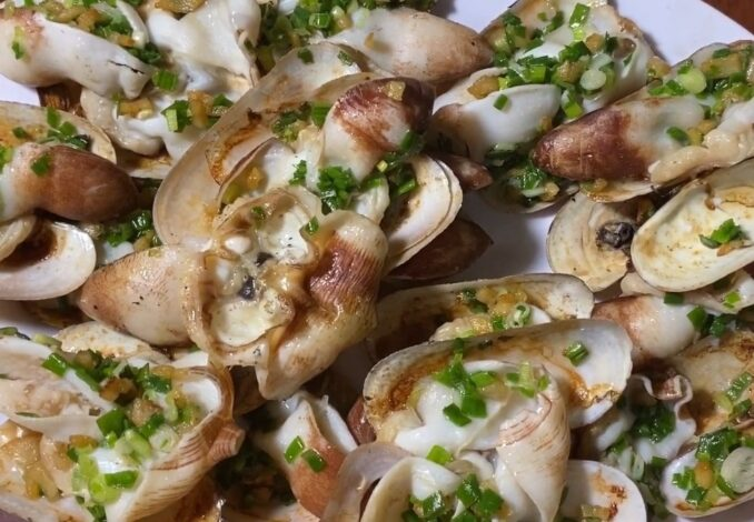 grilled snout otter clams with spring onion oil paste