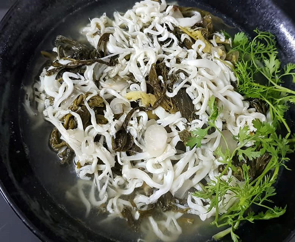 noodlefish soup with pickled cassava leaves