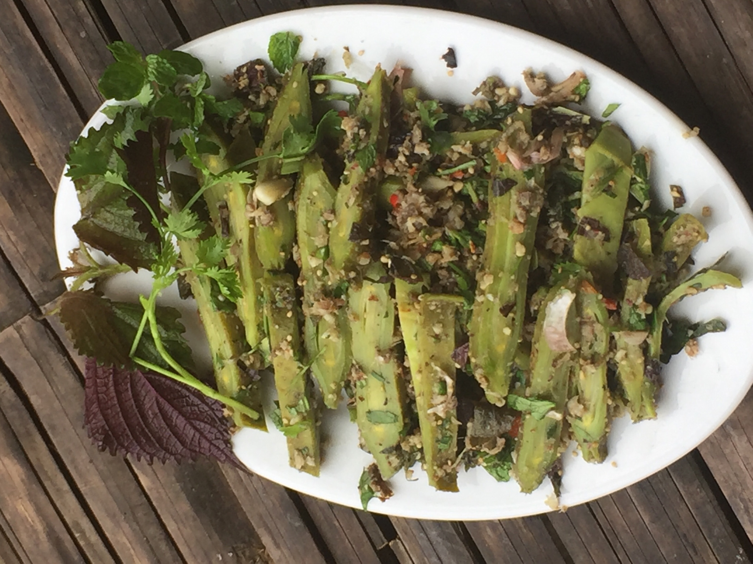 Oroxylum salad with finely-chopped grilled fish