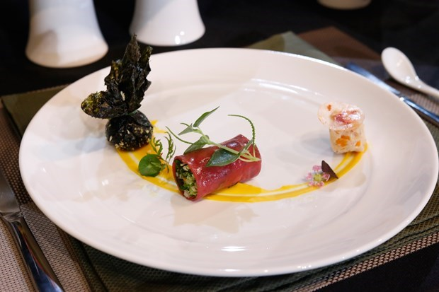 Veal roll with black plum sauce