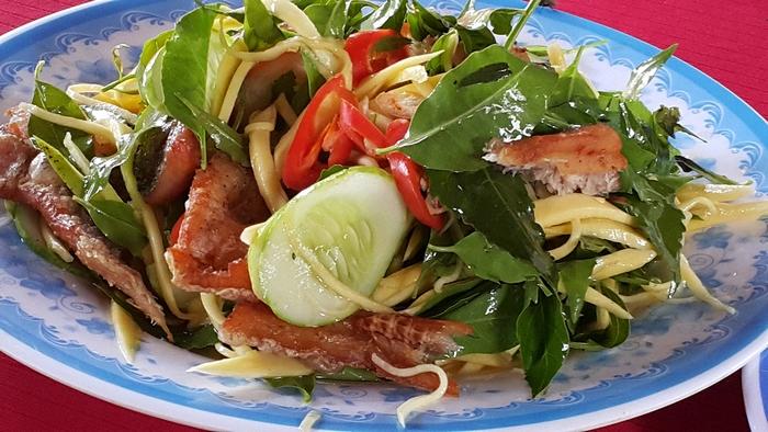 Neem leaf salad with dried Snakeskin gourami